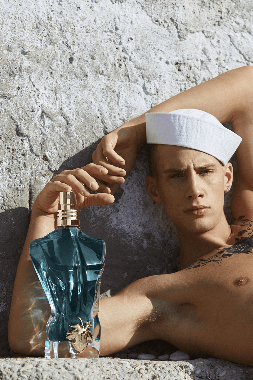 Visual of the new campaign with the sailor and the bottle Le Beau
